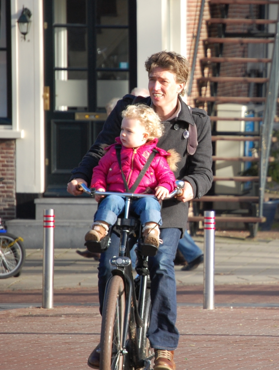 Cycling with your daughter between your arms