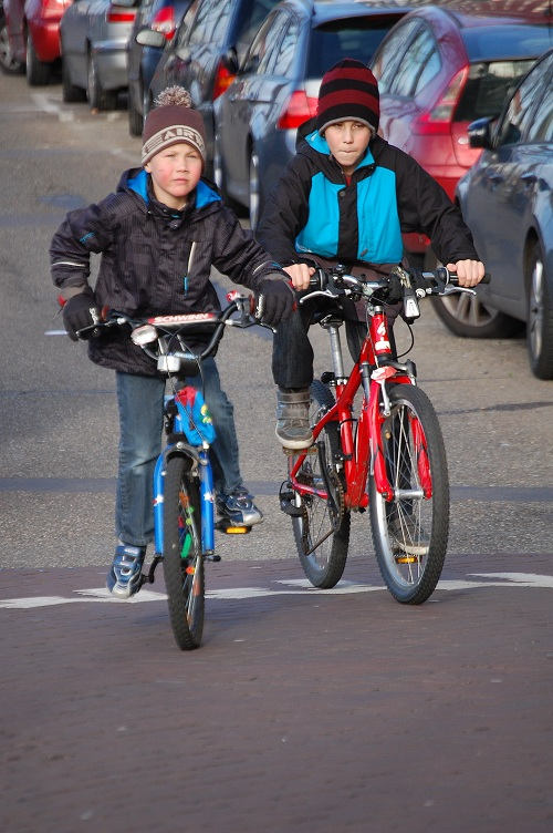 children cycling in Amsterdam by Joni